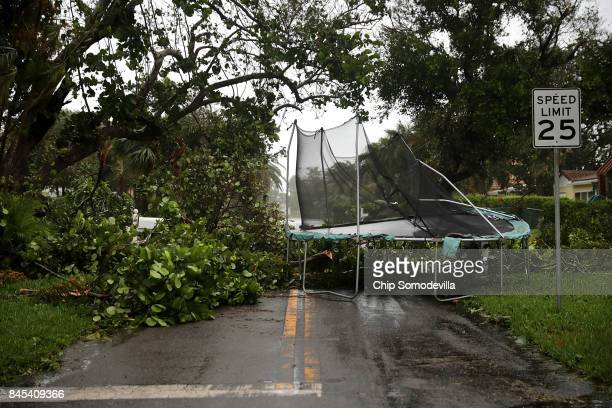 Downed trees and a windblown trampoline block a street as Hurricane Irma hits the southern part of the state September 10 2017 in Pompano Beach...