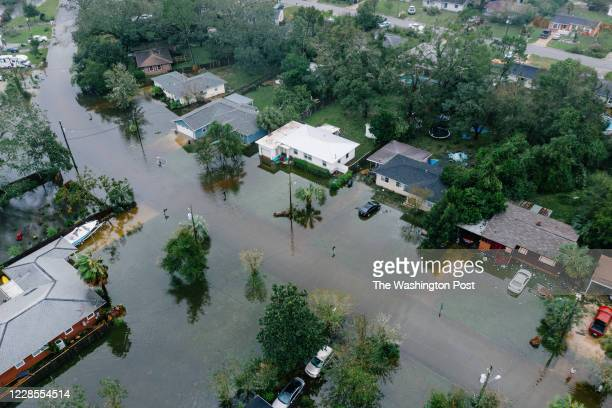 Downed trees and flooding in West Pensacola near the Bayou Grove and Mulworth neighborhoods The area received a lot of damage after Hurricane Sally...
