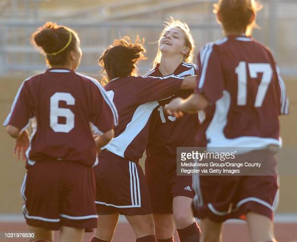 1/26/06 Downey High's Katherine Orellana back to camera hugs teammate Britney Vance after she scored their first goal against Warren High during...