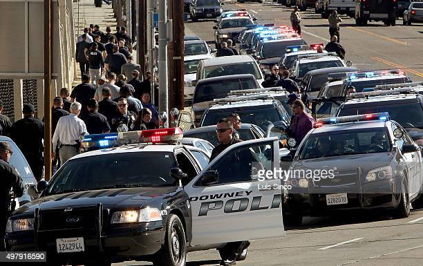 LOS ANGELES CALIF NOV 17 2015 Downey Police Department personnel gather at the coroner's office on Thursday morning Nov 19 after escorting the body...