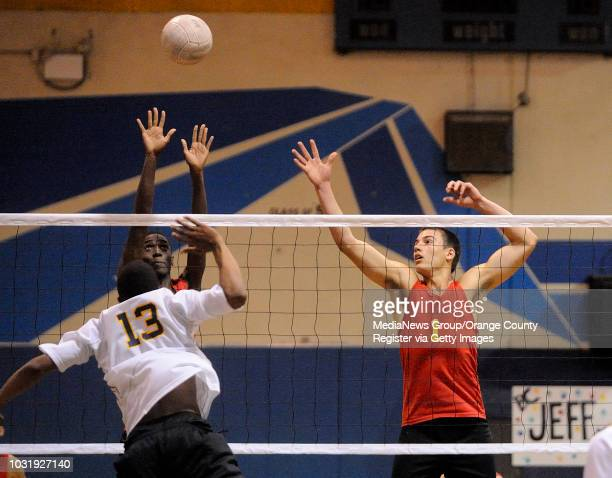DOWNEY CA Downey's Davion Matthews and Matt Taylor try to block a shot from Warren's Roderick Massey during their league game in Downey CA on May 5...