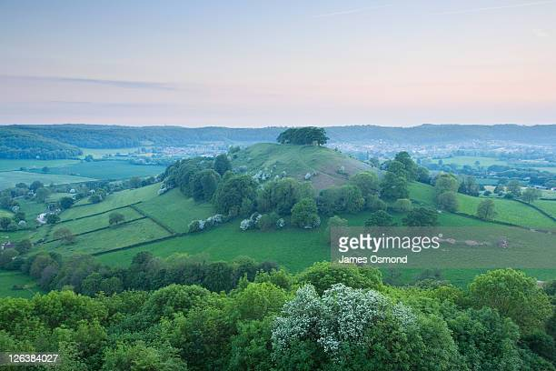 downham hill from uley bury at dusk. the cotswolds. gloucestershire. england. uk. - newpremiumuk stock pictures, royalty-free photos & images