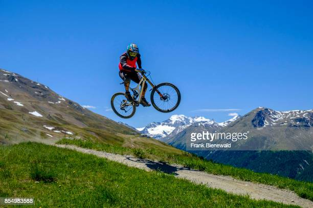 Downhill cyclist in action jumping in the Motolino Bike Park