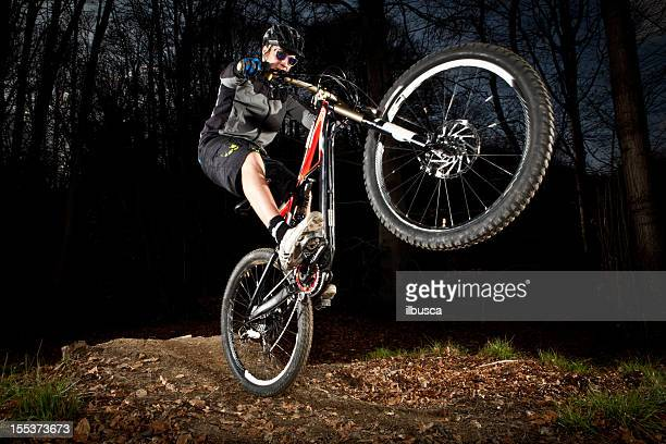 Downhill enduro mountain bike jump in the woods