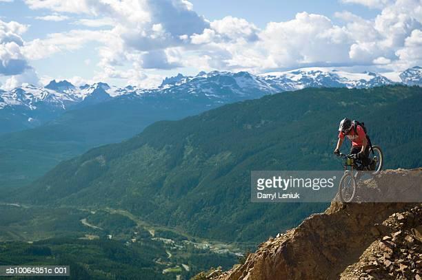 downhill mountain biker at whistler mountain bike park - whistler british columbia stock pictures, royalty-free photos & images