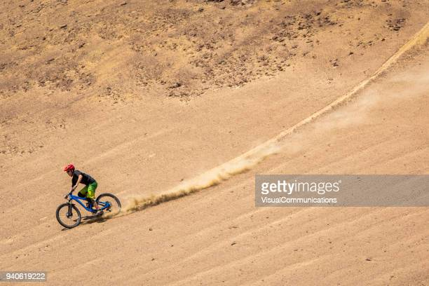 Downhill mountain biker freeriding in Paracas, Peru.
