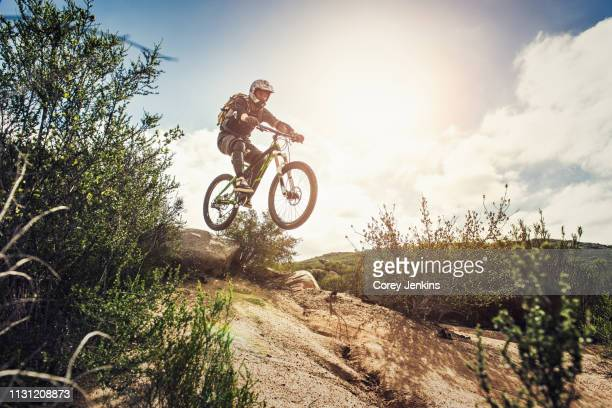 Downhill mountain biker jumping
