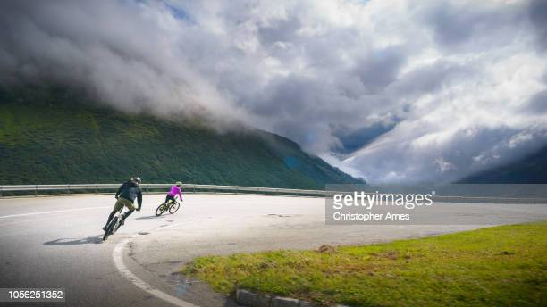 downhill mountain biking on road - 16x9 format stock pictures, royalty-free photos & images