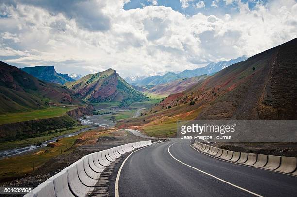 downhill on the m41 highway in kyrgyzstan - osh stock pictures, royalty-free photos & images