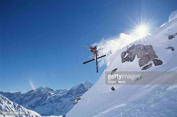 Downhill skier in midair, low angle view