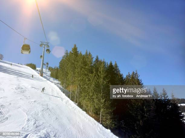 downhill skiing at ski slope in the austrian alps, tirol austria - upper bavaria stock photos and pictures