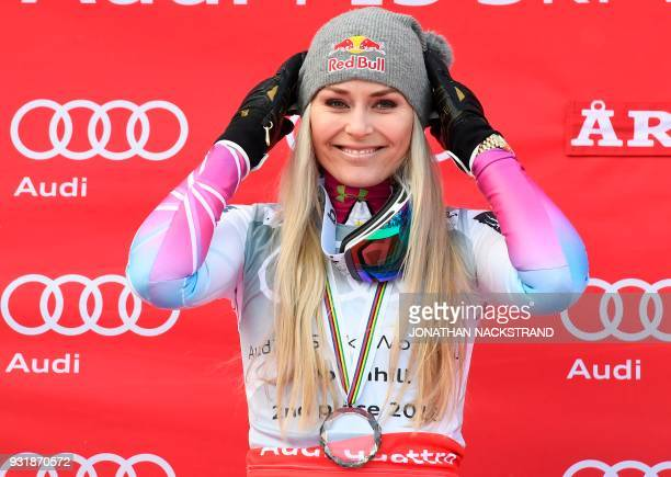 Downhill World Cup 2nd place US' Lindsey Vonn poses on the podium after the FIS Downhill World Cup event in Aare Sweden on March 14 2018 / AFP PHOTO...