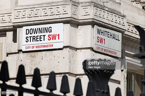 Downing Street and Whitehall street signs Westminster London UK