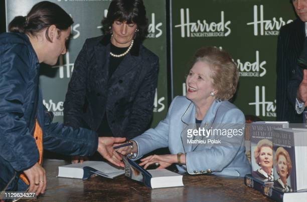 'Downing Street years' Margaret Thatcher signs her memoirs at Harrods