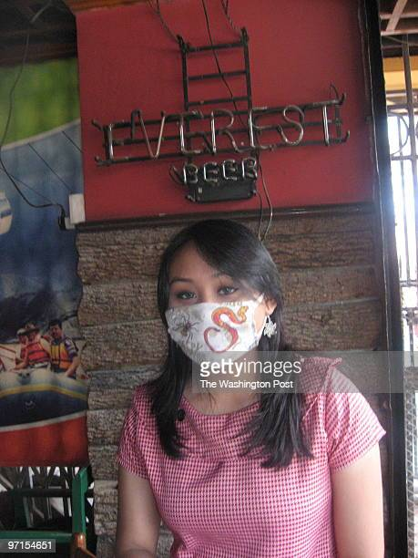 Downloaded Email 7/30/2009 WLG CREDIT Emily Wax / TWP Kathmandu Isha Amatya says she was forced to wear face masks to guard her from the city's...