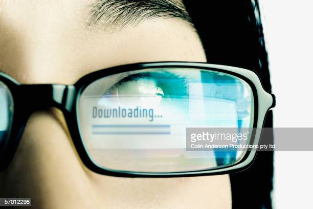 Downloading reflection in eyeglass lens