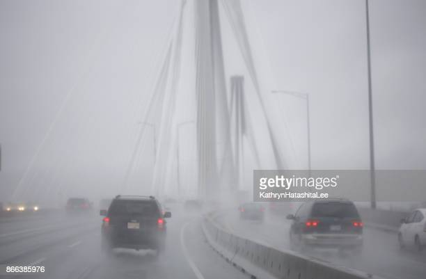 downpour on trans-canada highway, port mann bridge, surrey, british columbia in autumn - surrey british columbia stock photos and pictures