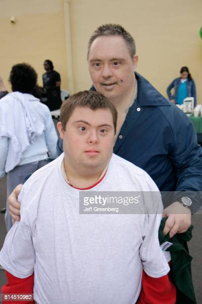 Down's Syndrome men at the Association for Development of Exceptional, MLK Day Carnival.