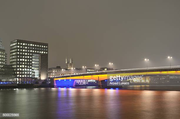 Downstream Building is located at the South side of London Bridge captured on a foggy day from the north side with the top of Southwark Cathedral in...