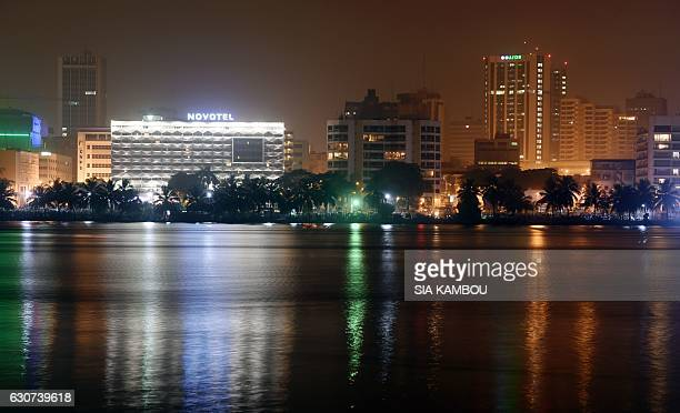 Downtown Abidjan is seen at night during New Year celebrations January 1 2017 / AFP / SIA KAMBOU