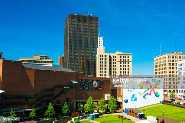 downtown akron skyline with akron sign and art - ohio stock photos and pictures