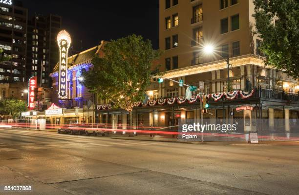 downtown austin texas at night - paramount theater austin stock photos and pictures