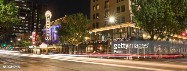 downtown austin texas panorama at night - paramount theater austin stock photos and pictures