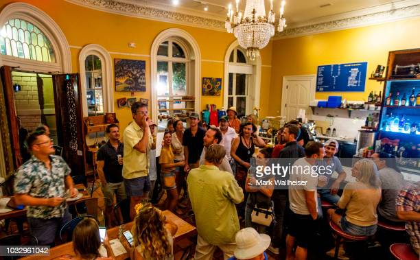 Downtown Bar owner of 1 Broad Street Michael Ray center left hosts a hurricane trivia party on September 13 2018 in Charleston South Carolina United...