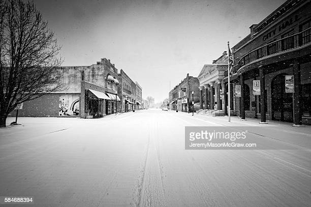 downtown bentonville after a heavy snow - bentonville stock photos and pictures