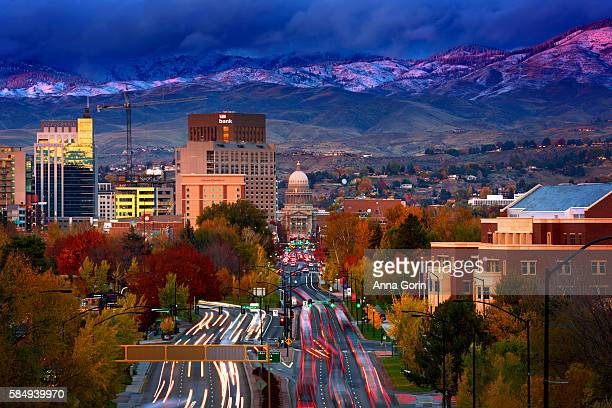 downtown boise idaho at sunset with fresh snow on foothills, viewed from depot hill, long exposure - boise idaho stock pictures, royalty-free photos & images
