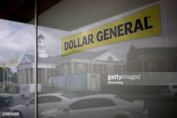 Downtown buildings are reflected in the window of a Dollar General Corp store in Scottsville Kentucky US on Tuesday May 26 2015 Dollar General Corp...