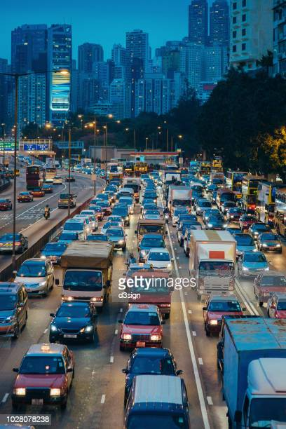 Downtown cityscape and rush hour traffic on busy highway in the evening