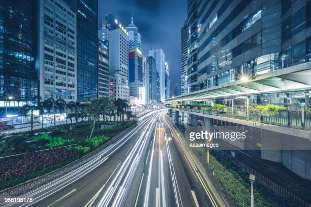 downtown cityscape at night of hong kong - elevated walkway stock pictures, royalty-free photos & images