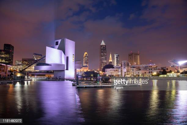 downtown cleveland city skyline in ohio usa - rock and roll hall of fame cleveland stock photos and pictures