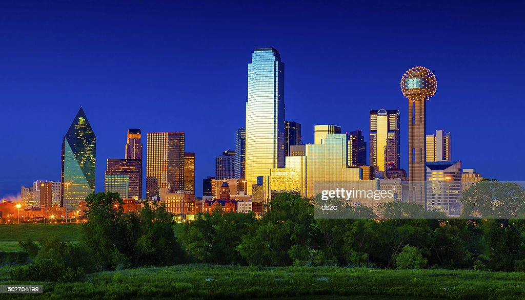 Downtown Dallas Cityscape Skyline Skyscrapers glowing at dusk / twilight : Stock Photo