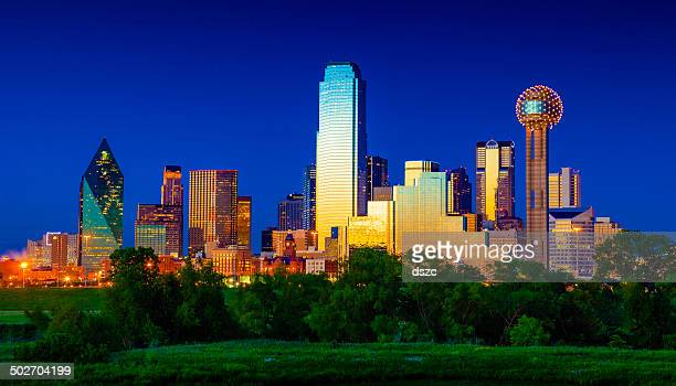 downtown dallas cityscape skyline skyscrapers glowing at dusk / twilight - dallas stock pictures, royalty-free photos & images