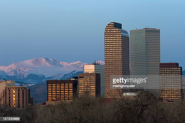 Downtown Denver skyline and pink alpenglow on Mount Evans