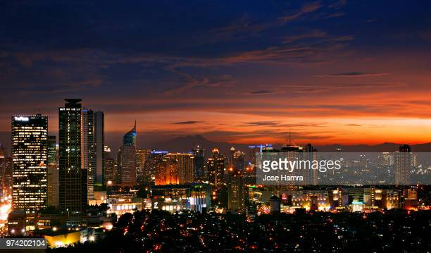 downtown district at night, jakarta, indonesia - java stock pictures, royalty-free photos & images