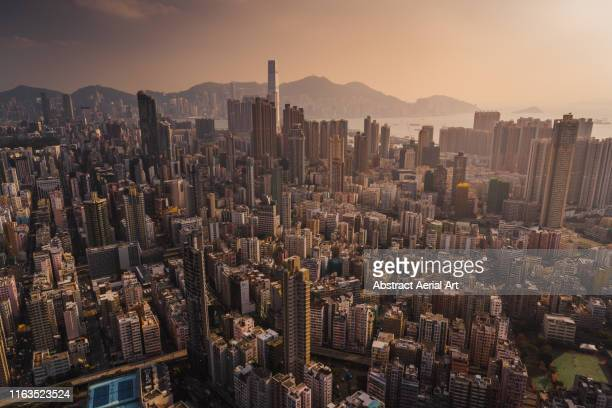 downtown district at sunset, kowloon, hong kong - urban sprawl stock pictures, royalty-free photos & images
