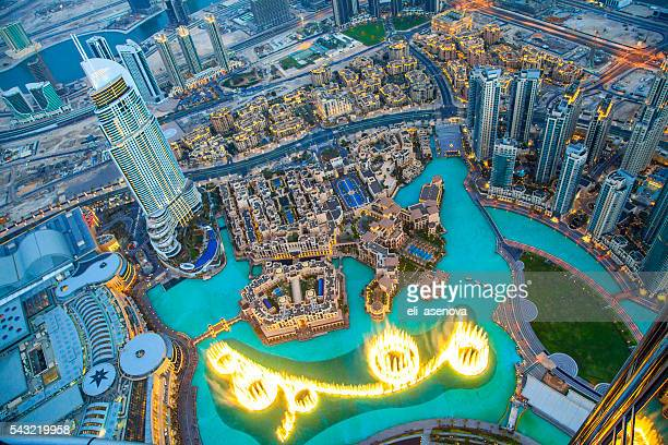 downtown dubai at night. - standing water stock pictures, royalty-free photos & images