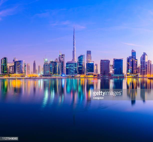 downtown dubai city skyline and business park at sunset, united arab emirates. - skyline stock pictures, royalty-free photos & images