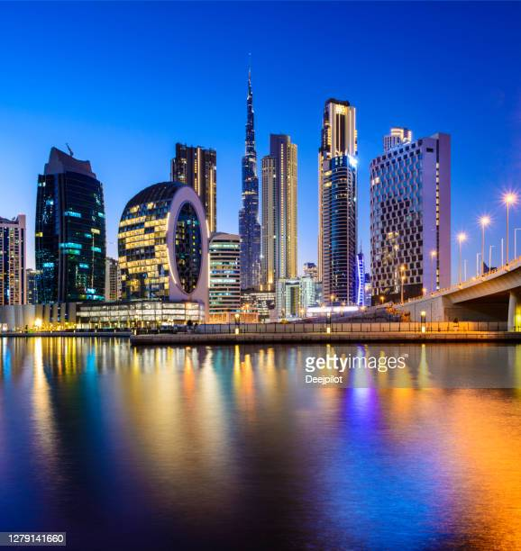 downtown dubai city skyline and business park at sunset, united arab emirates - international landmark stock pictures, royalty-free photos & images