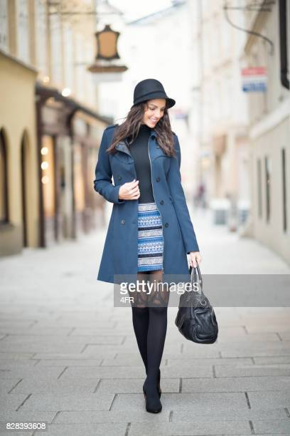 downtown fashion, streets of salzburg - black boot stock pictures, royalty-free photos & images
