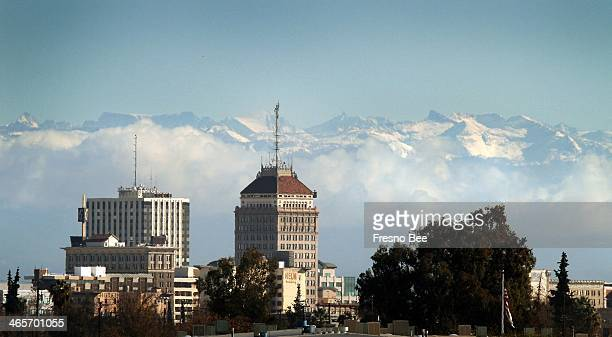 Downtown Fresno Calif skyline can be seen below snow caps the Sierra Nevada mountains and clouds along the foothills Dec 14 2009