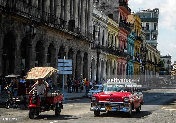CONTENT] Downtown Havana Colorful buildings cars and rickshaw