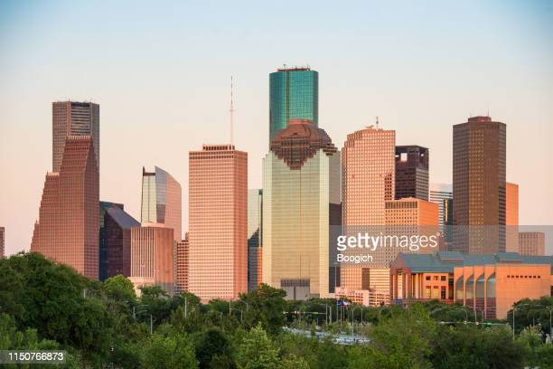 downtown houston texas buildings at dusk - houston stock pictures, royalty-free photos & images