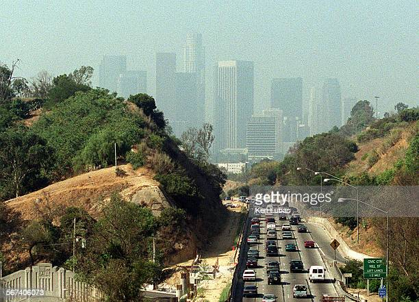 Downtown is barely visible in this view of Traffic heading south on the Pasadena Freeway into Los Angeles in this view from Elysian Park.