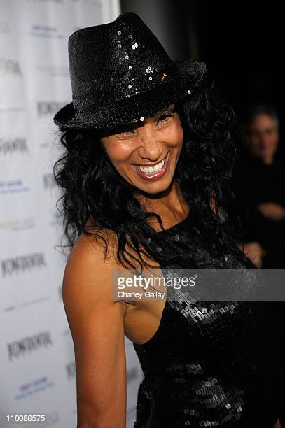 Downtown Julie Brown poses at The Los Angeles Confidential Men's Issue Party with Ryan Seacrest and Bill Maher at Craft on October 29, 2008 in Los...