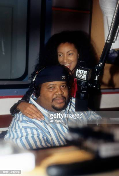 Downtown Julie Brown visits with Doctor Dre' when she stops by the Hot 97 Radio Studios on November 1, 1995 in New York City.