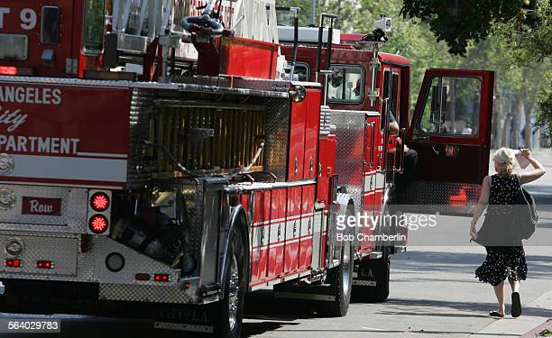 Downtown loft resident Cherry Wood runs to catch up with fire truck to chat with the firemen as she has embarked on a one woman crusade to save the...